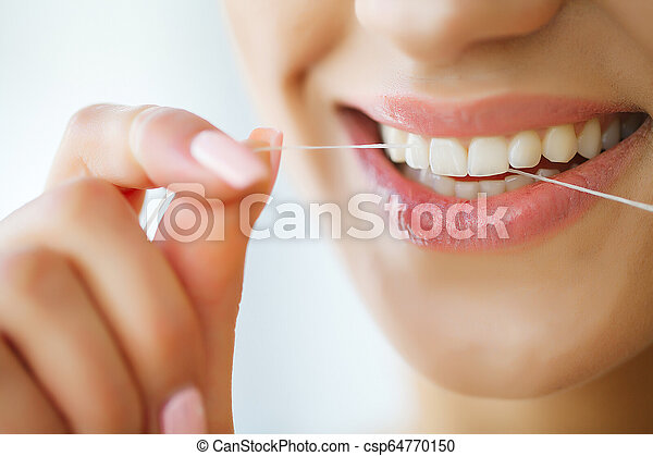 Dental Care Woman With Beautiful Smile Using Floss For Teeth High Resolution Image