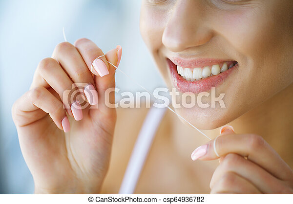 Dental Health Woman With Beautiful Smile Flossing Healthy Teeth High Resolution Image