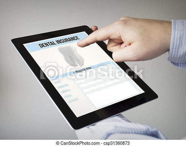 dental insurance on a tablet - csp31360873