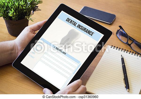 dentale verzekering, tablet, desktop - csp31360960