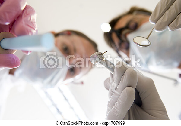 Dentist and assistant holding pick and mirror - csp1707999