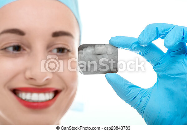 Dentist looking at dental x-ray - csp23843783
