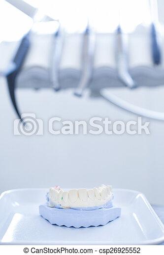 Denture model with specialist dental tools - csp26925552