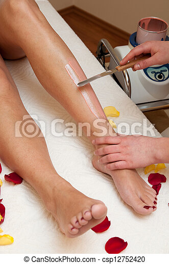 Depilation with wax in beauty salon - csp12752420