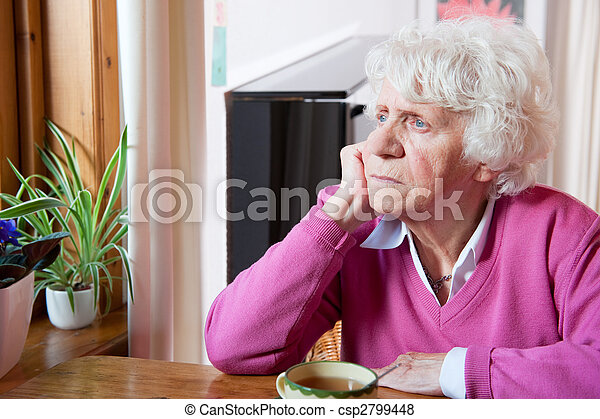 Depressed elderly woman sitting at the table - csp2799448