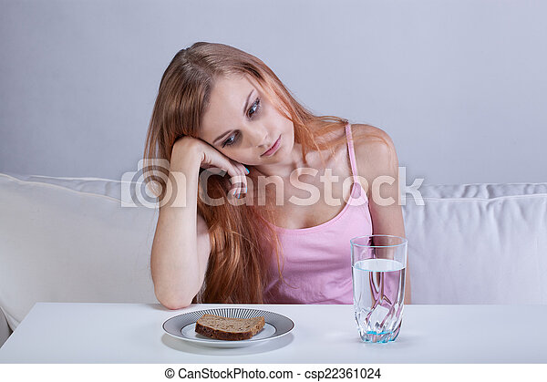 Depressed girl with eating disorder - csp22361024