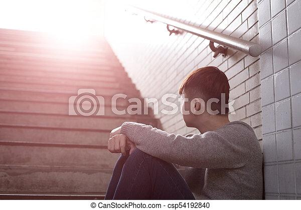 depressed man sit in underground - csp54192840