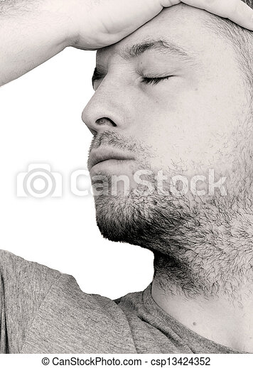 depressed man with head in his hands - csp13424352
