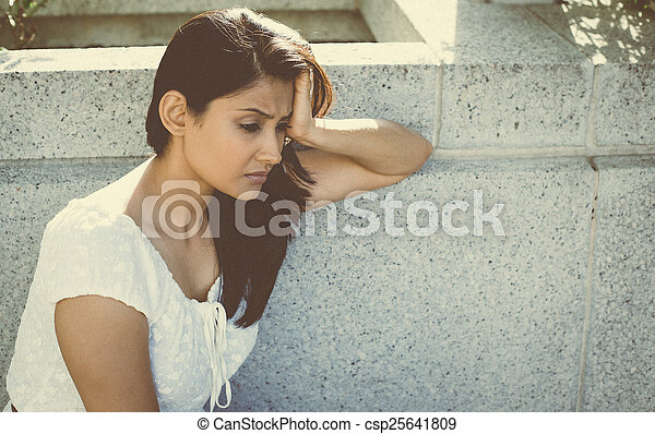 Depressed woman in white - csp25641809