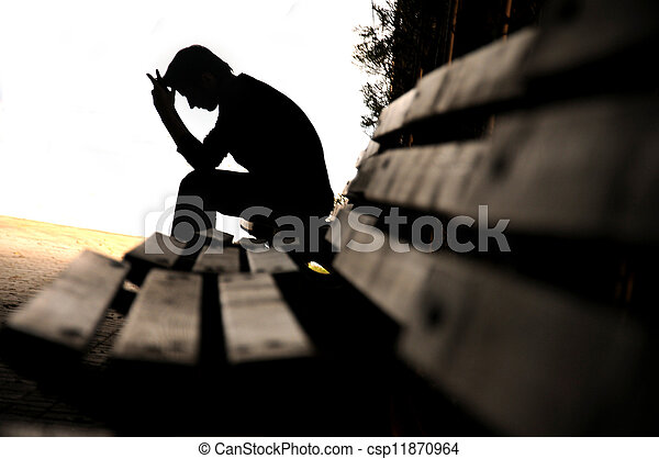 depressed young man sitting on the bench - csp11870964