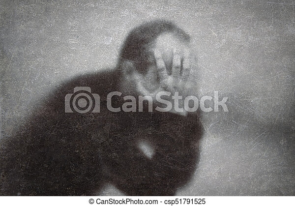 Depression. Broken man behind a dusty scratched glass. - csp51791525