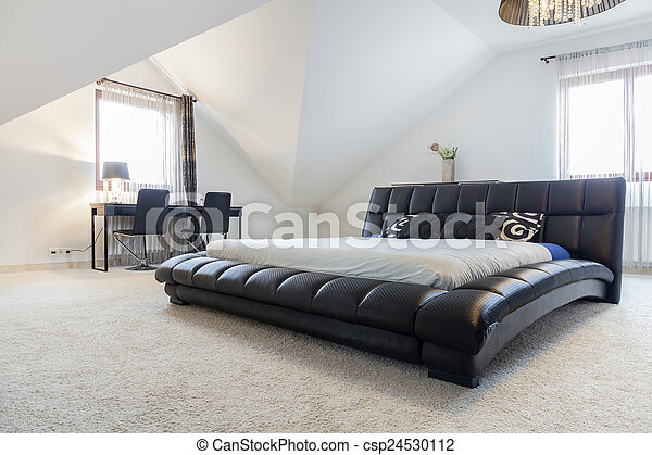 Designed bed in modern bedroom - csp24530112