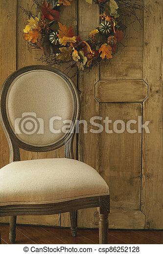 Designer chair with wreath on door - csp86252128