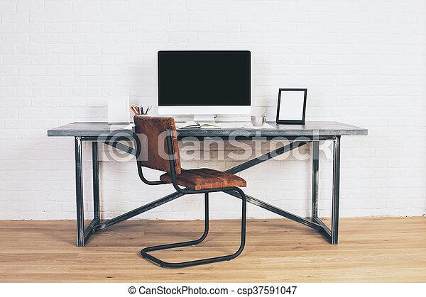 Designer desk with blank display. Front view of designer desk with ...