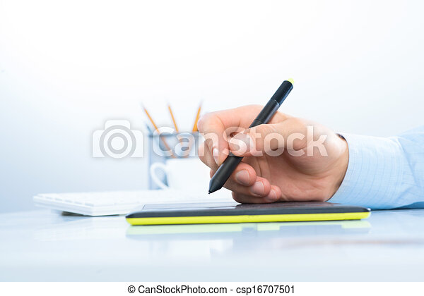 Designer hand drawing a graph on the tablet - csp16707501