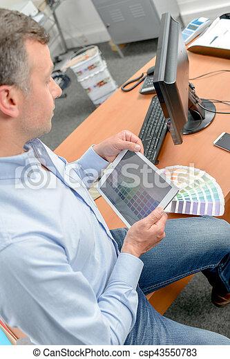 Designer using tablet computer - csp43550783