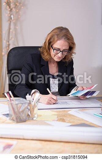 Designer working at home office - csp31815094