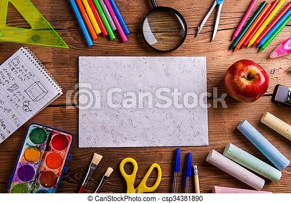 Desk, school supplies, empty paper, wooden background - csp34381890