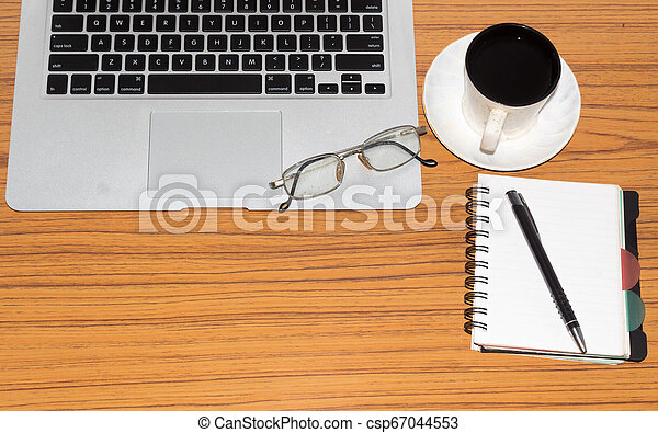 Desk with open notebook with blank pages, eye glasses, pen and a cup of coffee. Top view with copy space. Business still life concept with office stuff on table. Education, working or planning concept - csp67044553