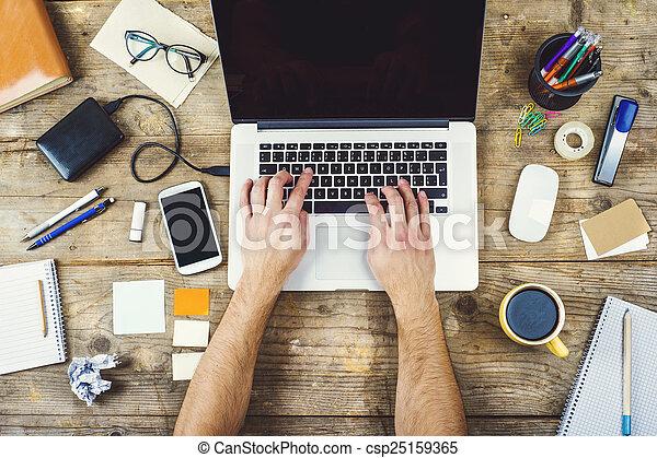 Desktop mix on a wooden office table. - csp25159365