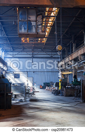 Desolate crane in an old valve factory hall - csp20981473