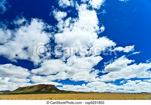 Desolate landscape with beautiful cloudscape - csp9291850