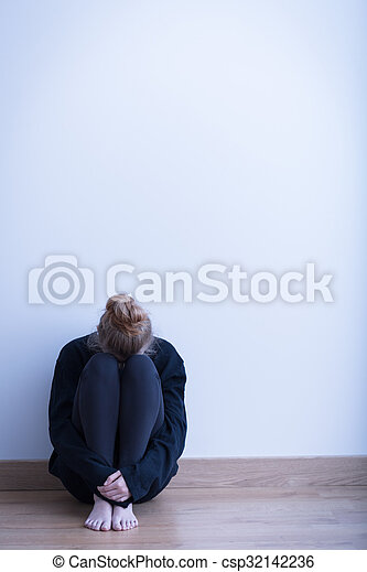 Despair girl in empty room - csp32142236