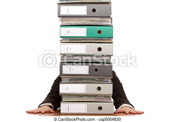 Desperate business woman sits behind folder stack - csp5004830