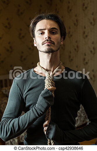Desperate man hold a noose around his neck. - csp42938646