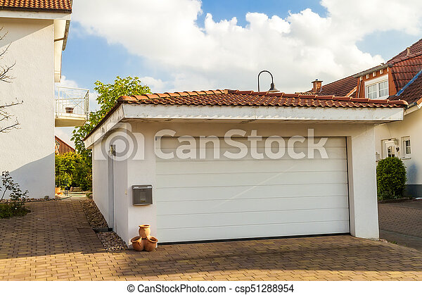 Detached white garage with orange brick tile roof - csp51288954