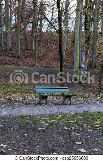 Detail of a Bench in a Park in Autumn - csp25656680