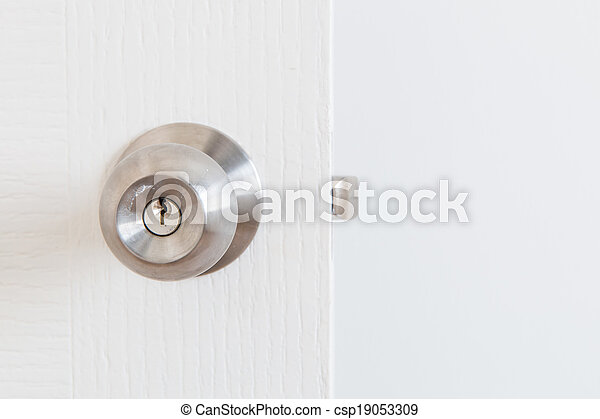 Detail of a metallic knob on white door , tainless steel round b - csp19053309