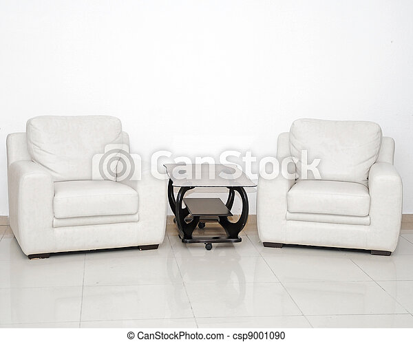 Detail of a modern living room with white armchair and glass coffee table - csp9001090