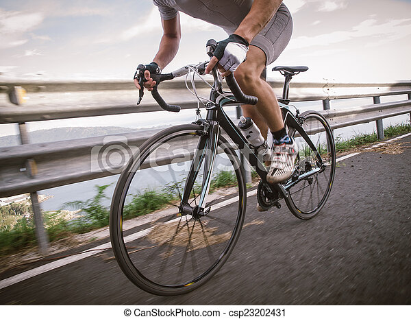 Detail of a road bike with a cyclist pedaling - csp23202431