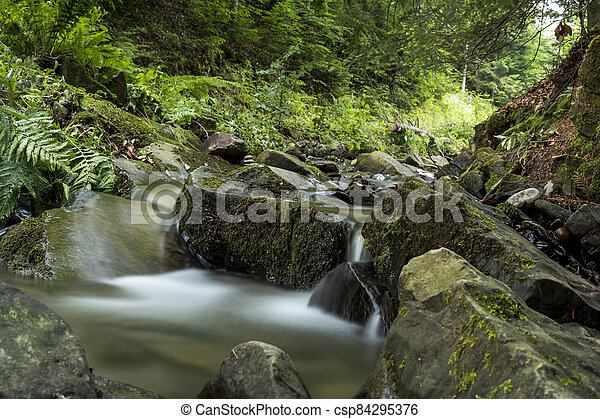 detail of cascade on a small stream - csp84295376
