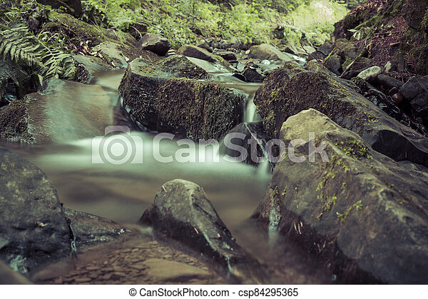 detail of cascade on a small stream - csp84295365