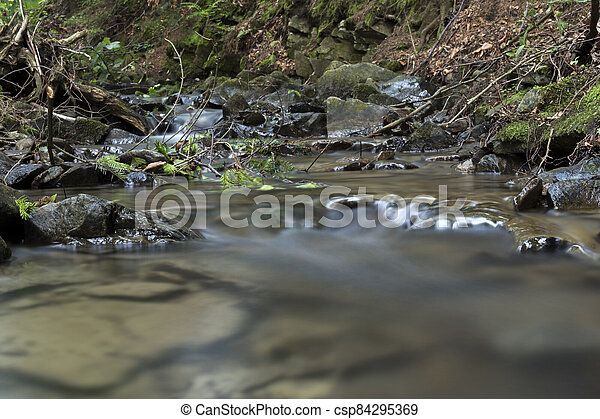 detail of cascade on a small stream - csp84295369