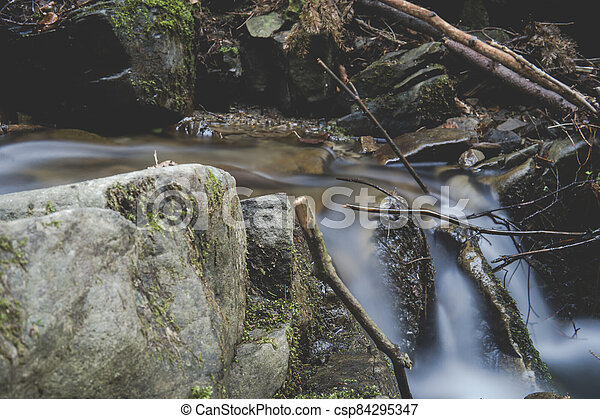 detail of cascade on a small stream - csp84295347