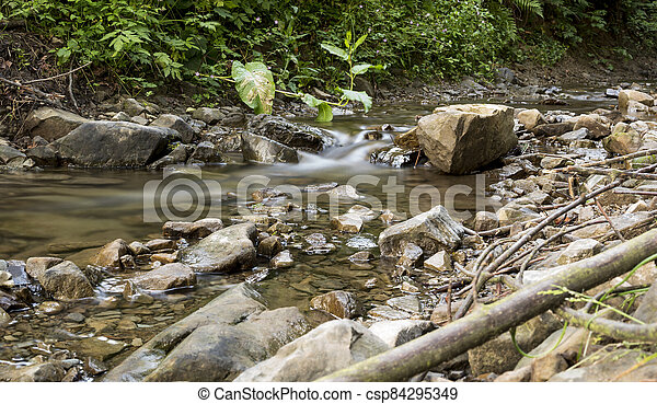 detail of cascade on a small stream - csp84295349