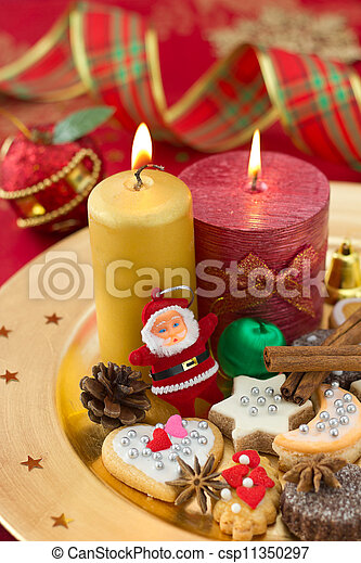 Detail of Christmas cookies with candles on golden plate - csp11350297
