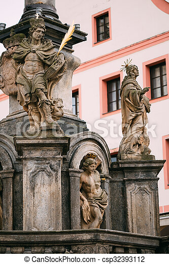 Detail of Column. Statue on main town square in Cesky Krumlove, - csp32393112