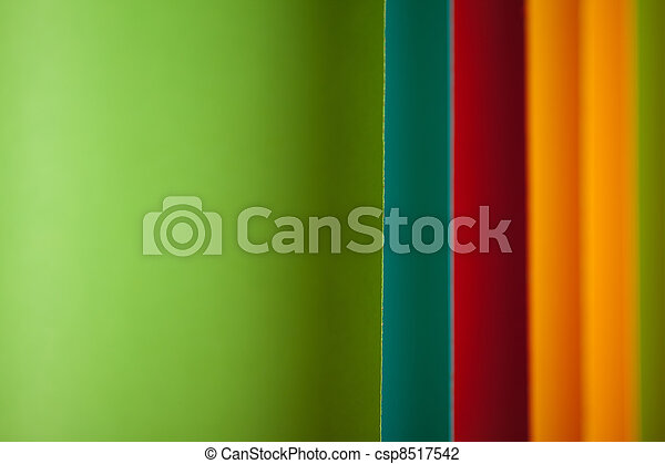 detail of curved, colored sheets of paper - csp8517542