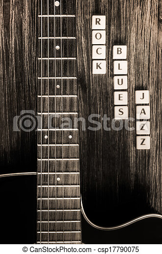 Detail of guitar and signs rock blues jazz in vintage style - csp17790075