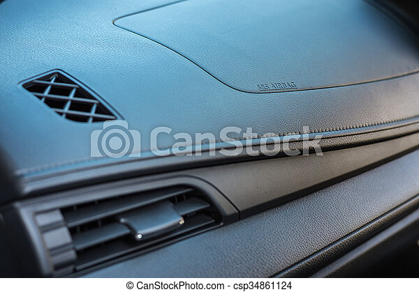 detail of new modern car interior focus on airbag. Black Bedroom Furniture Sets. Home Design Ideas