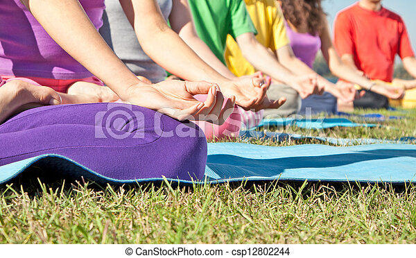 Detail of people in Yoga lotus position. Yoga concept. - csp12802244