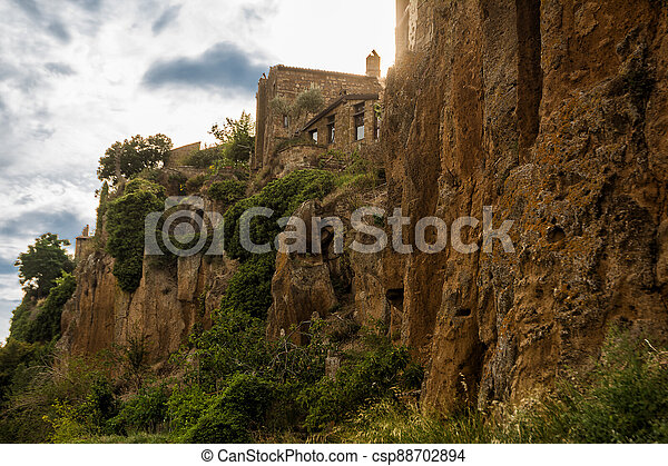 Detail of the houses carved into the tuff in Civita di Bagnoregio, Lazio, Italy - csp88702894