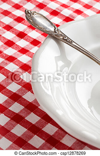 detail of vintage cutlery on white plate - csp12878269