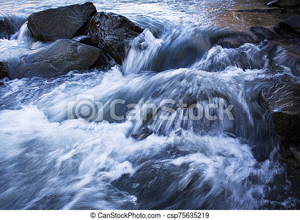 detail of wild river with stones - csp75635219