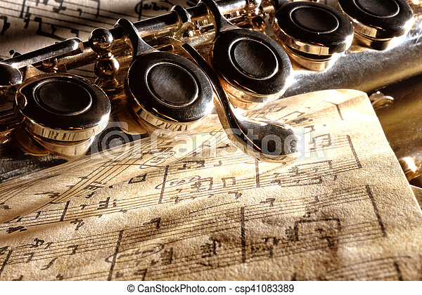 Detail transverse flute on old handwritten sheet music