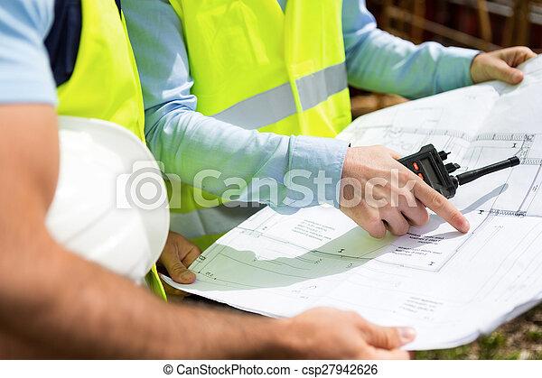 Details of blueprints on a construction site - csp27942626